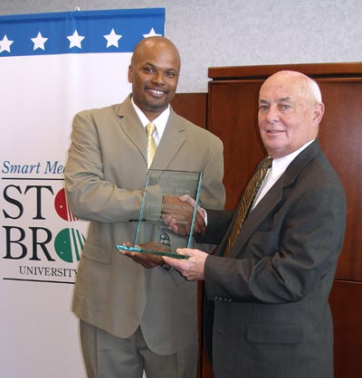 Dr. Phillips receives the 2005 Maffetone Community Service Award